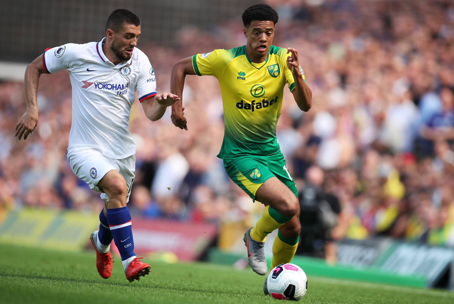 Norwich City's Jamal Lewis is pursued by Chelsea's Mateo Kovacic during their Premier league match at Carrow Road in Norwich on Saturday. (Reuters Photo)