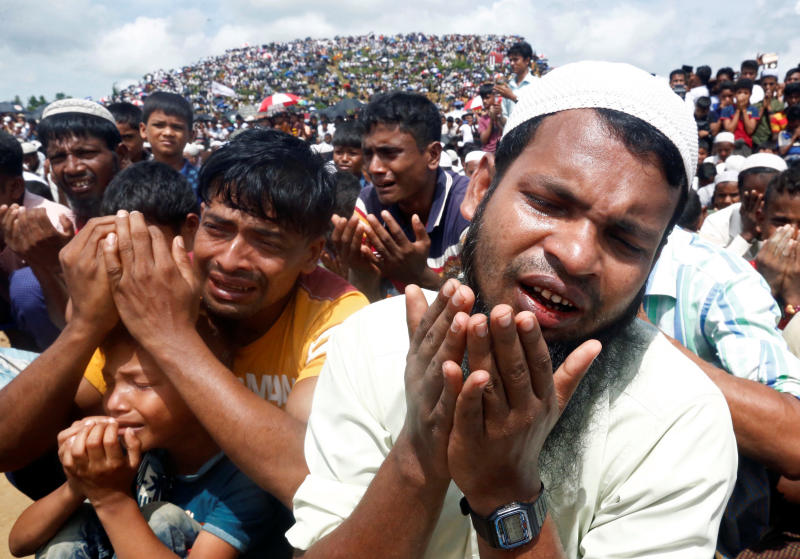 Rohingya refugees take part in a prayer as they gather to mark the second anniversary of the exodus at the Kutupalong camp in Cox's Bazar, Bangladesh, on Sunday. (Reuters photo)