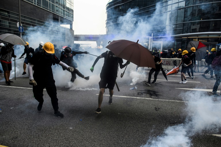 Saturday's clashes saw police baton-charge protesters and fire tear gas.