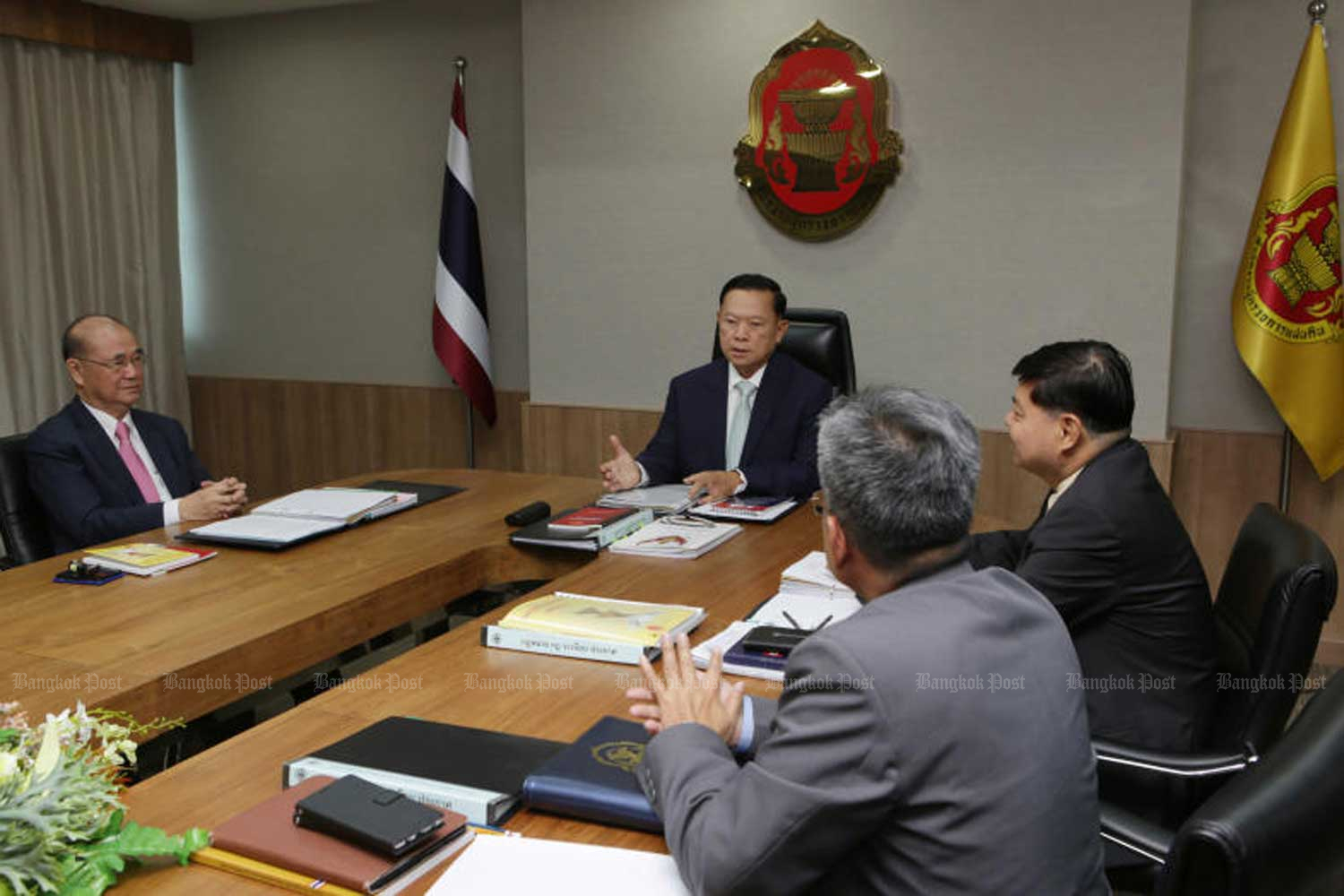 Members of the Ombudsman meet at their office in Bangkok on Tuesday to consider complaints about the cabinet's swearing-in. (Photo by Apichit Jinakul)