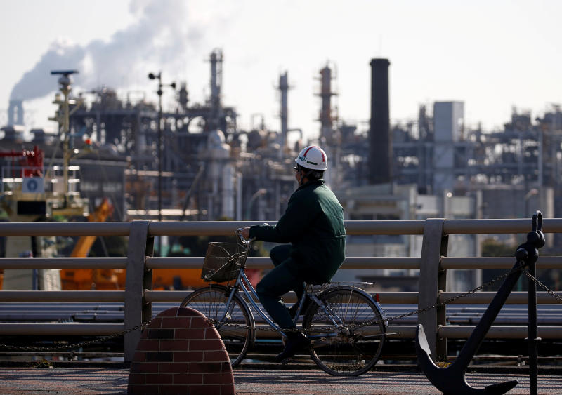 A worker cycles near a factory at the Keihin industrial zone in Kawasaki, Japan Feb 28, 2017. (Reuters file photo)