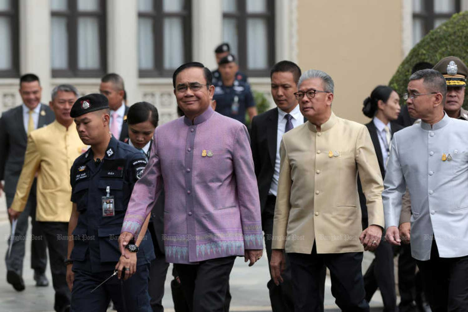 Prime Minister Prayut Chan-o-cha, centre, at Government House in Bangkok on Tuesday. (Photo by Chanat Katanyu)