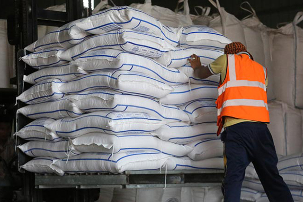 A worker moves sacks of rice inside a warehouse in Phnom Penh. (Khmer Times photo)