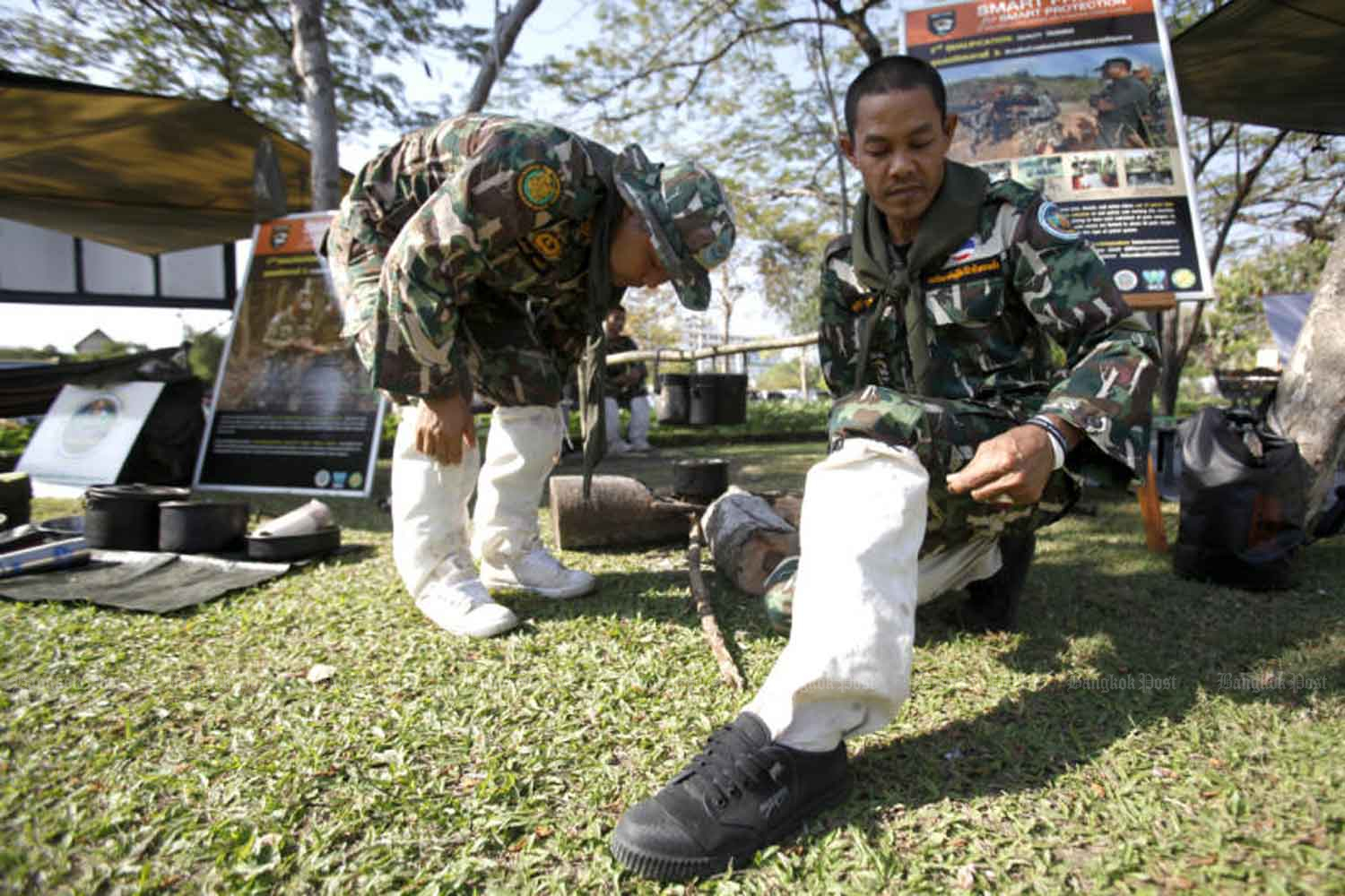 Forestry officials at Huai Kha Khaeng Wildlife Sanctuary try wearing cloth leg guards to protect themselves from leech bites. (File photo by Thanarak Khunton)