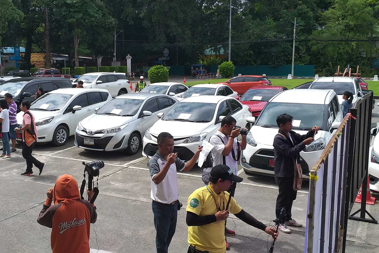 More than 20 cars are seized from three suspects preying on car owners and business operators providing car rental services in Phuket province. The suspects rented cars from victims and then sold them. (Photo by Achadtaya Chuenniran)
