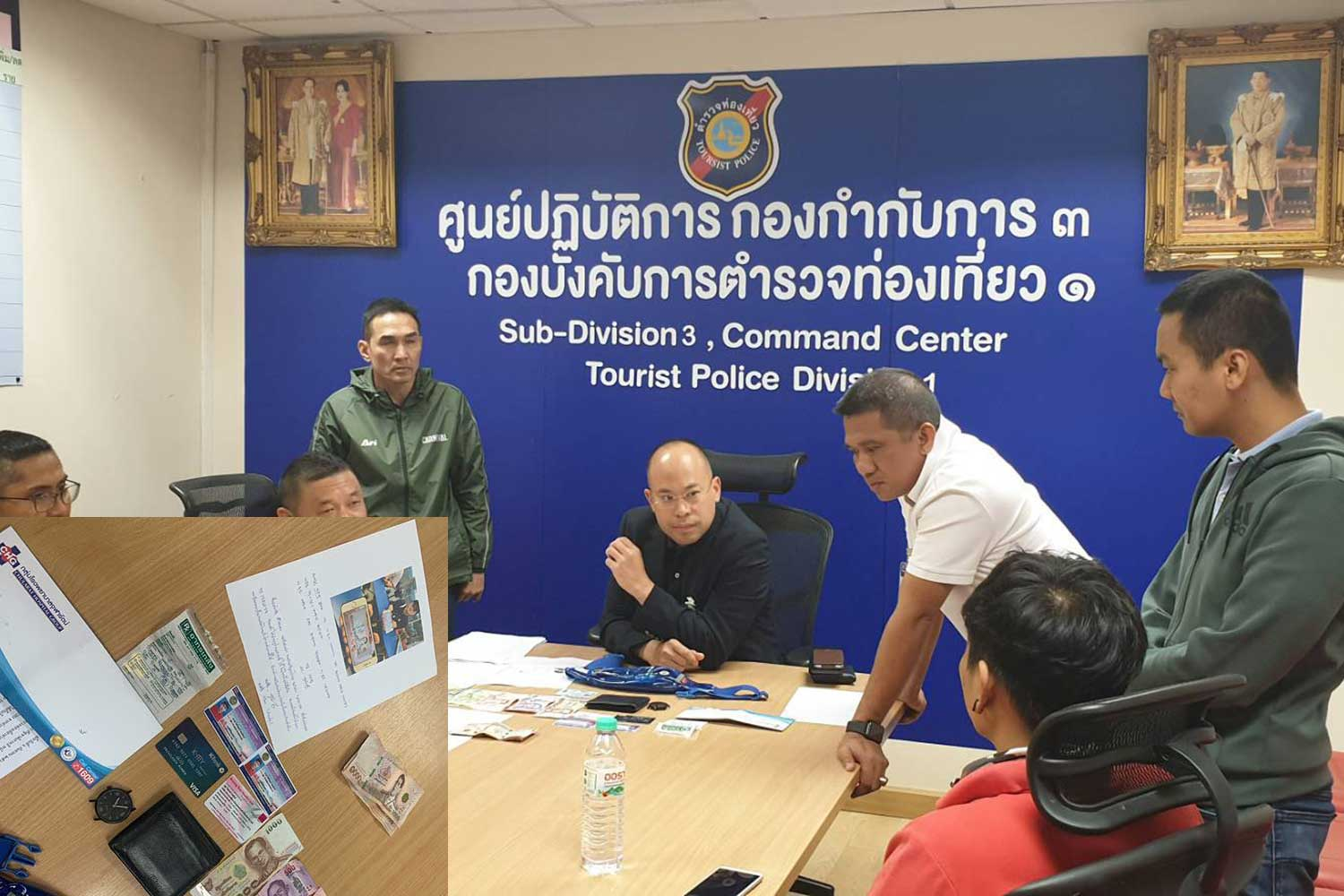Police interrogate baggage handler Phairin Pholkhan (red T-shirt), who is accused of stealing cash from the luggage of a Korean woman at Suvarnabhumi airport. (Photo by Sutthiwit Chayutworakan)