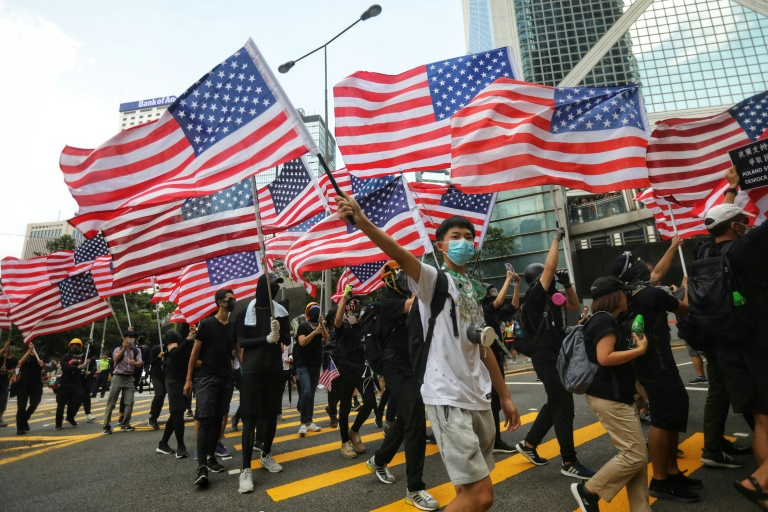Many of those marching waved American flags.