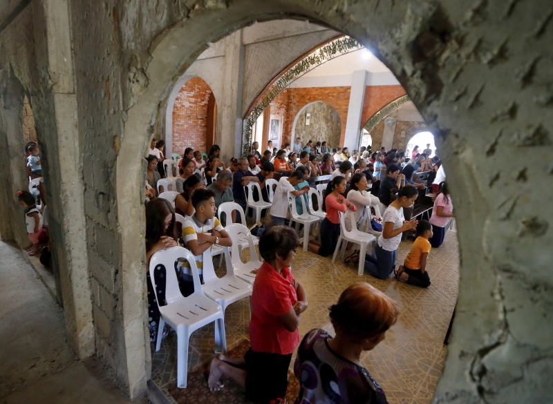 In this Jan 27, 2019 photo, worshippers attend a Sunday Mass officiated by a substitute priest in the chapel built by US priest Father Pius Hendricks in the village of Talustusan on Biliran Island in the central Philippines. (AP photos)