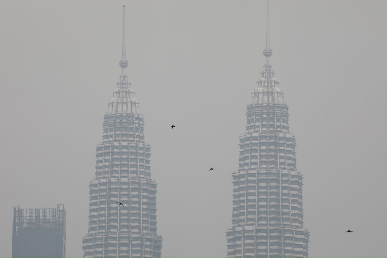 Petronas Twin Towers are shrouded by haze in Kuala Lumpur on Monday. (Reuters photo)