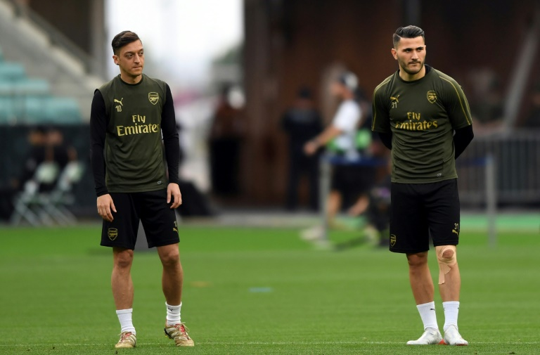 English football need to wake up to the threat to footballers and their families security in the wake of the attack on Arsenal stars Mesut Ozil and Sead Kolasinac security expert Alex Bomberg told AFP