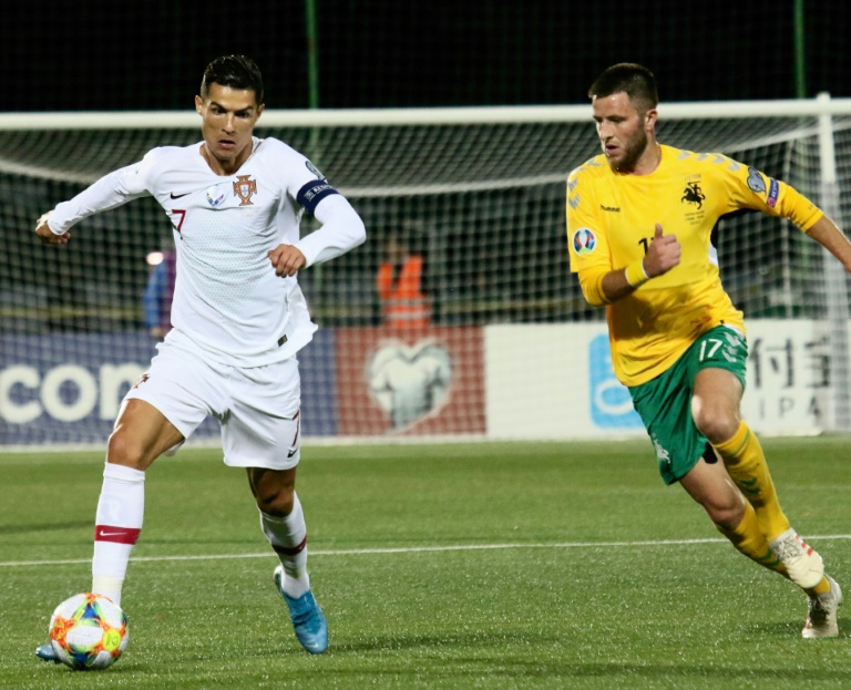 Portugal's Cristiano Ronaldo scored four goals for the second time on the international stage as Portugal hammered Lithuania.