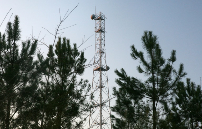Investigators are looking into how mobile devices can be connected to several phone towers at once, among other issues.