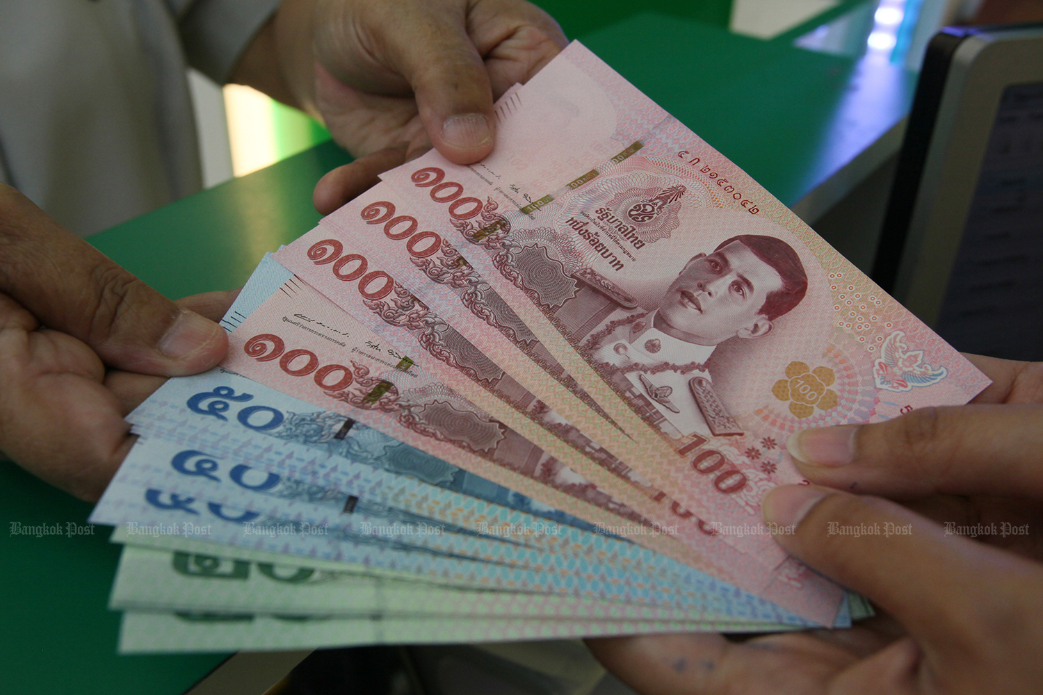 Thailand's effort to revive economic growth with more than 316 billion baht of stimulus faces an obstacle from its surging currency. (Bangkok Post photo)
