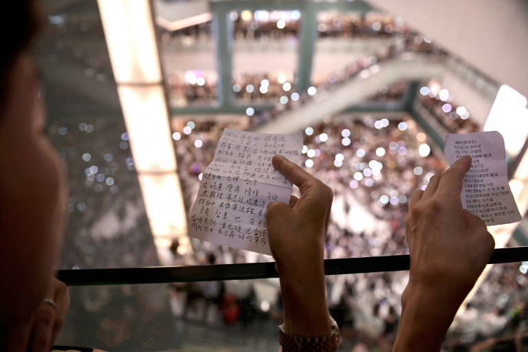 Protesters have gathered at Hong Kong malls to sing a new anthem penned by an anonymous composer.