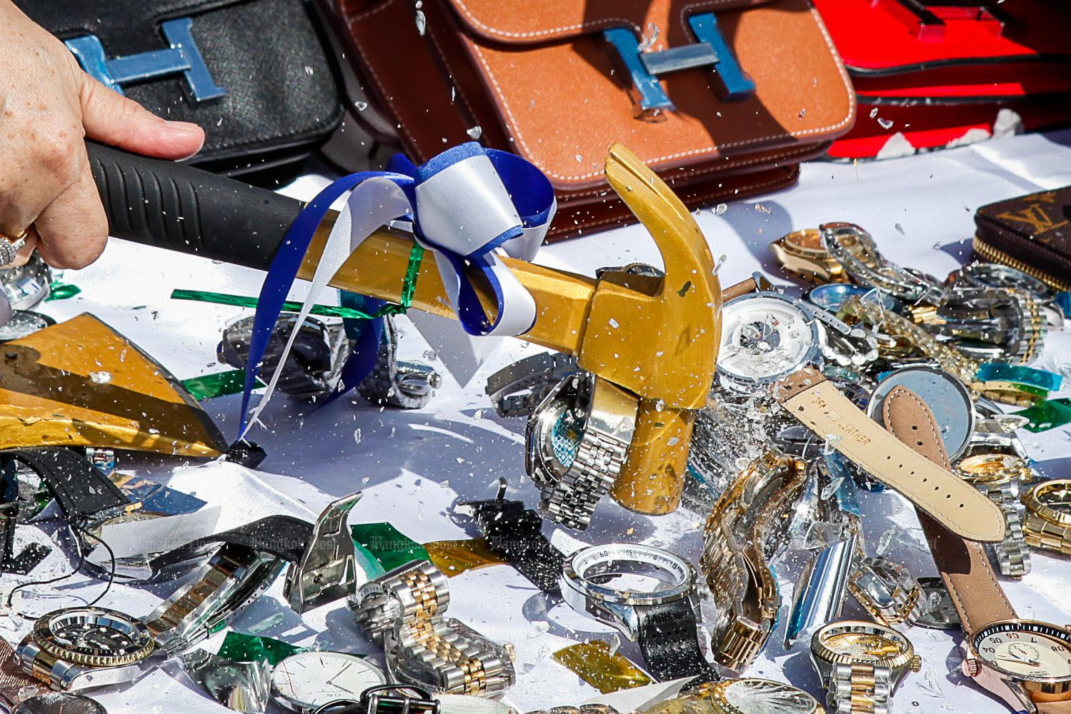 Counterfeit Rolex watches are among the more than 10 million seized items to be destroyed by the Customs Department. (Photo byWatcharawit Phudork)