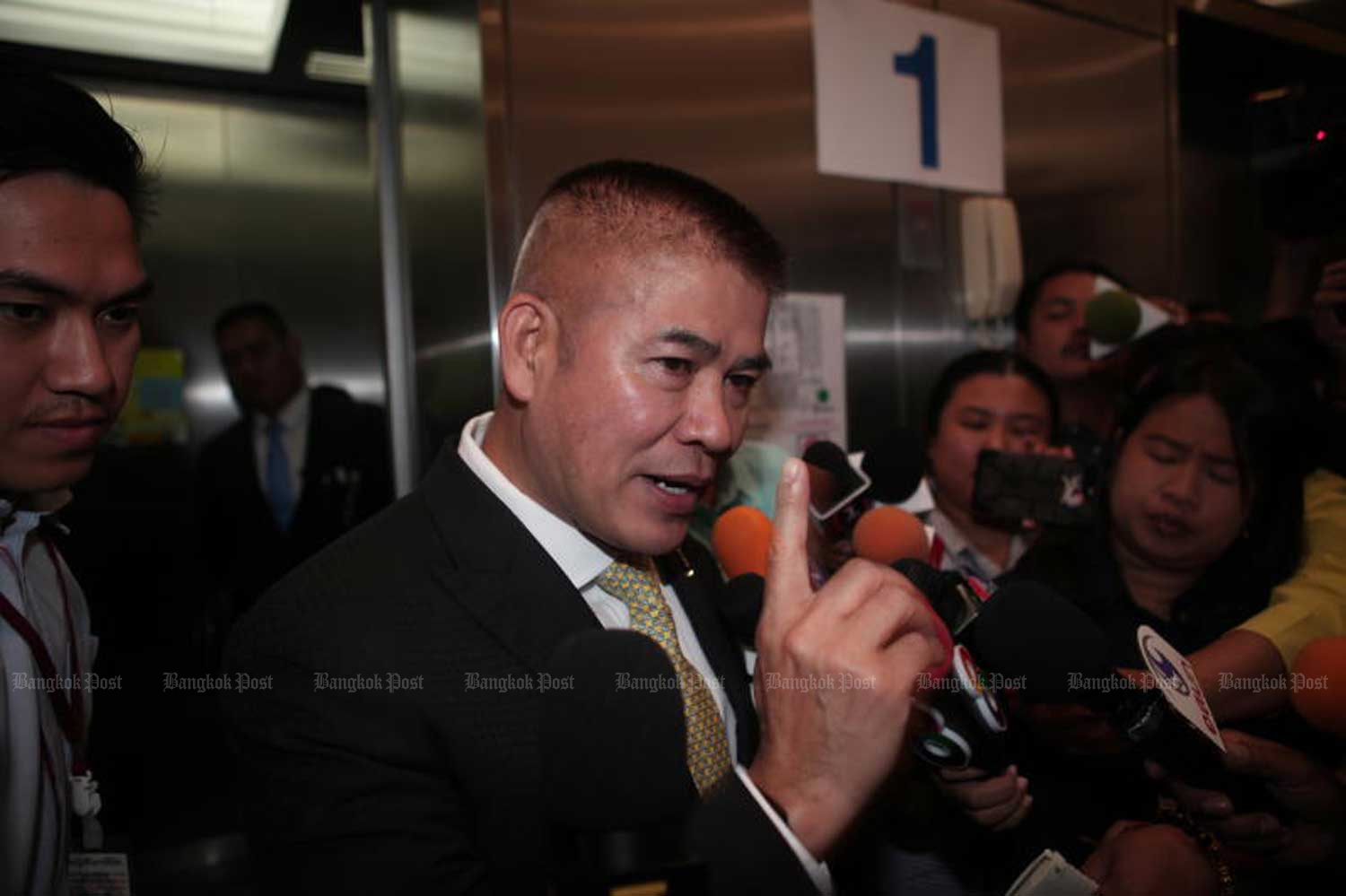 Deputy Agriculture and Cooperatives Minister Thamanat Prompow speaks with reporters at Parliament in Bangkok on Friday. (Photo by Apichart Jinakul)