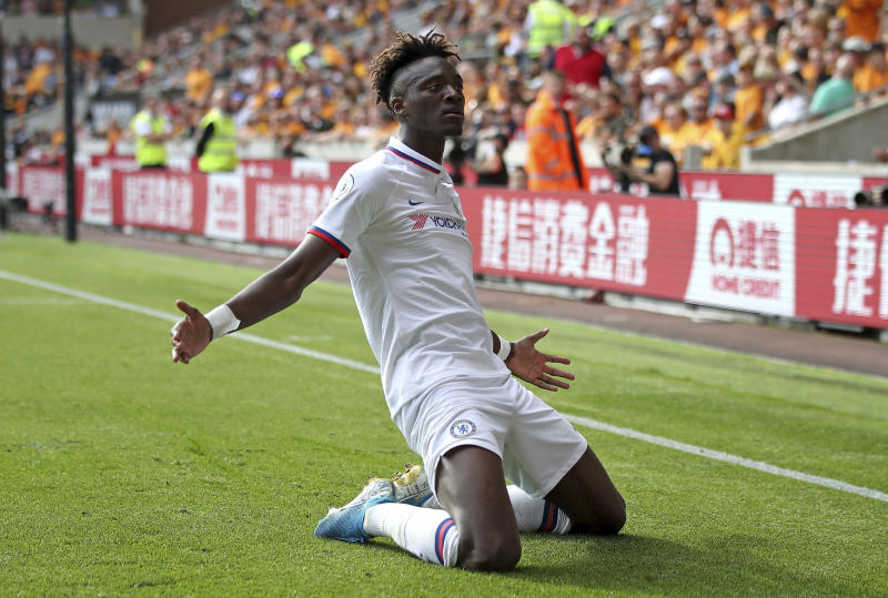 Chelsea's Tammy Abraham celebrates scoring his side's fourth goal of the game against Wolverhampton Wanderers at Molineux on Saturday. (AP photo)