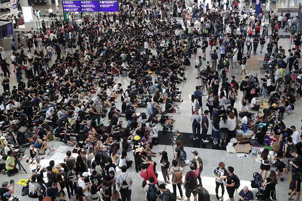 Protesters stage a sit-in at Hong Kong International Airport on Aug 9. (South China Morning Post photo)