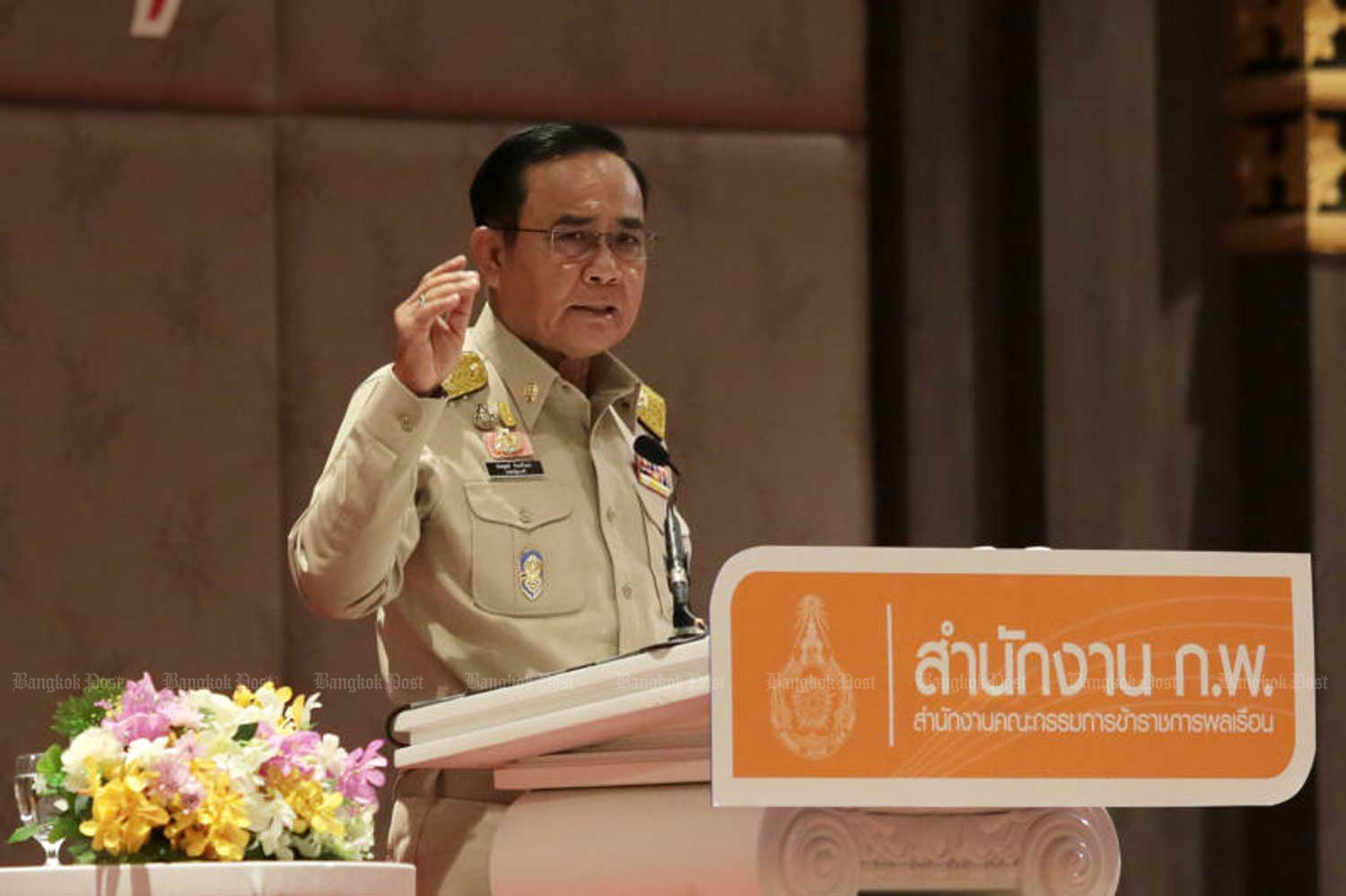 Prime Minister Prayut Chan-o-cha addresses a seminar on the implementation of national strategies at the Impact convention complex in Nonthaburi province on Monday. (Photo by Chanat Katanyu)