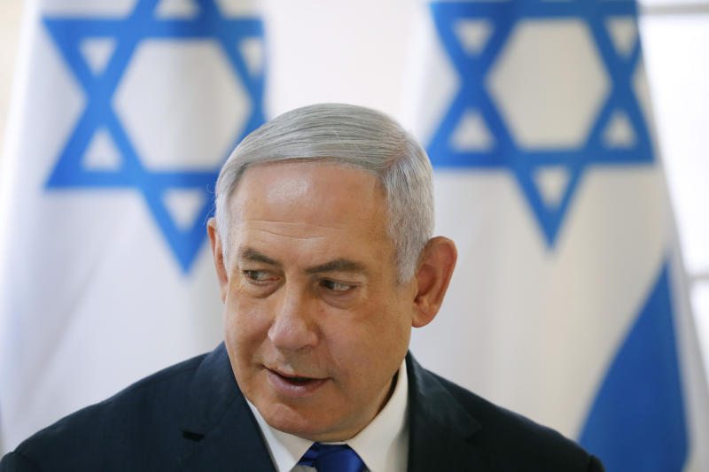 Israeli Prime Minister Benjamin Netanyahu chairs the weekly cabinet meeting being held in the Jordan Valley, in the Israeli-occupied West Bank, on Sunday. (AP photo)