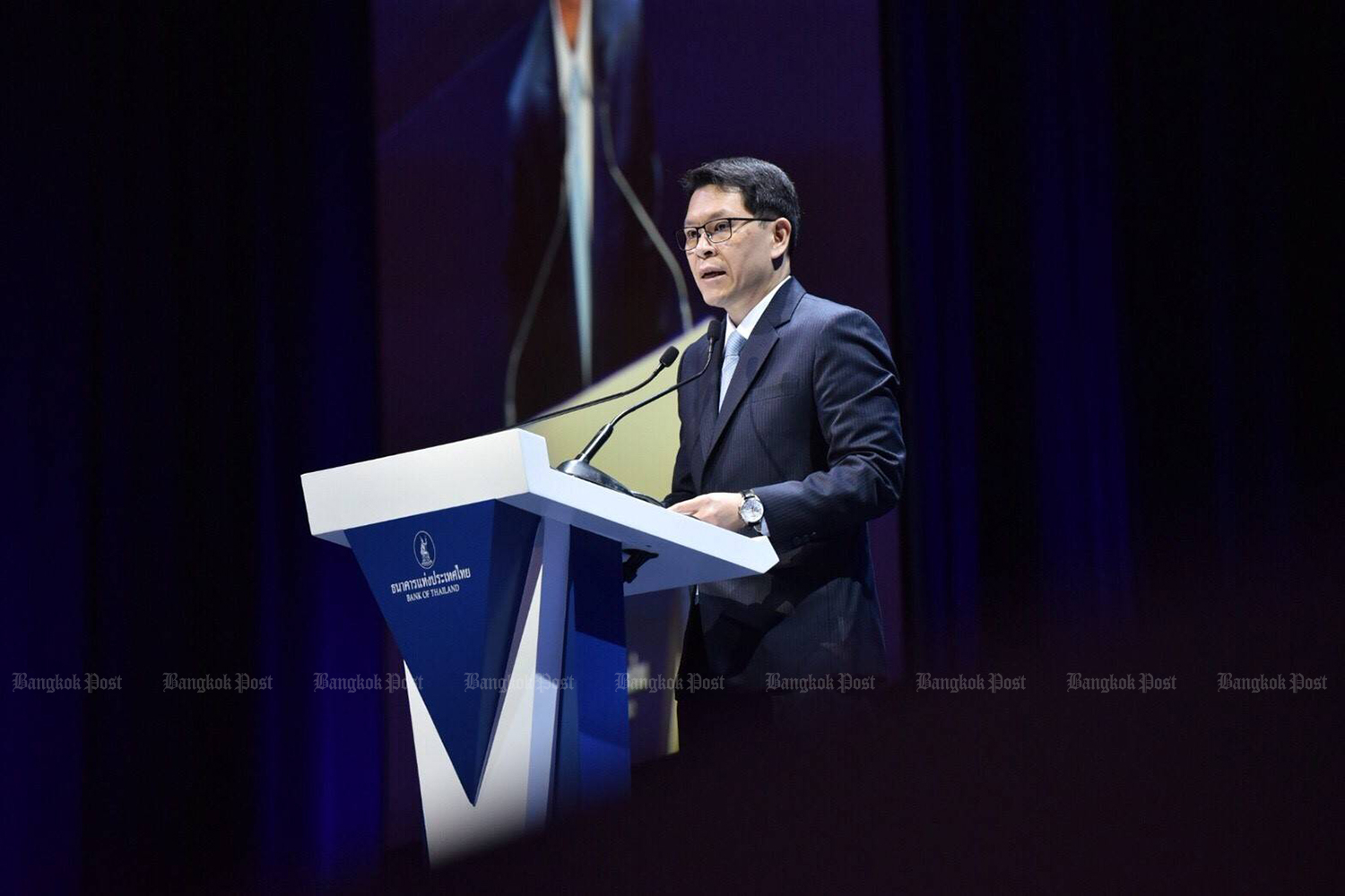Bank of Thailand governor Veerathai Santiprabhob says zero-interest unsecured loans and online shopping are blamed for the country's swelling household debt. (Bangkok Post file photo)