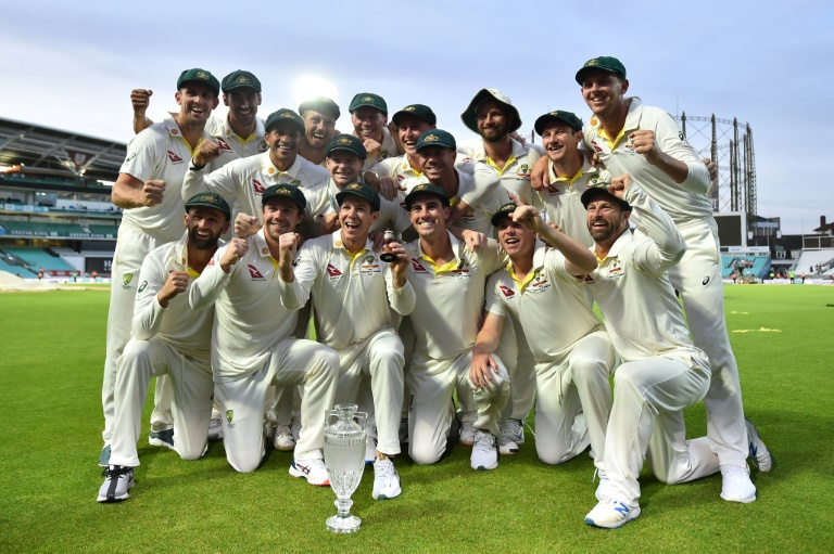 Australia's captain Tim Paine,(C holding the Ashes Urn), said winning the first Test at Edgbaston, where Australia triumphed by 251 runs, had been crucial for his side's confidence