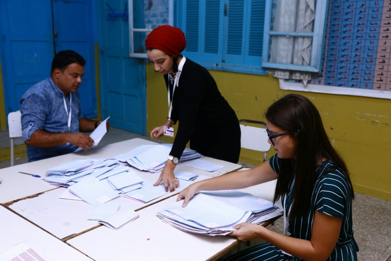 Tunisian volunteers count ballots at a polling station in Sousse, south of the capital Tunis