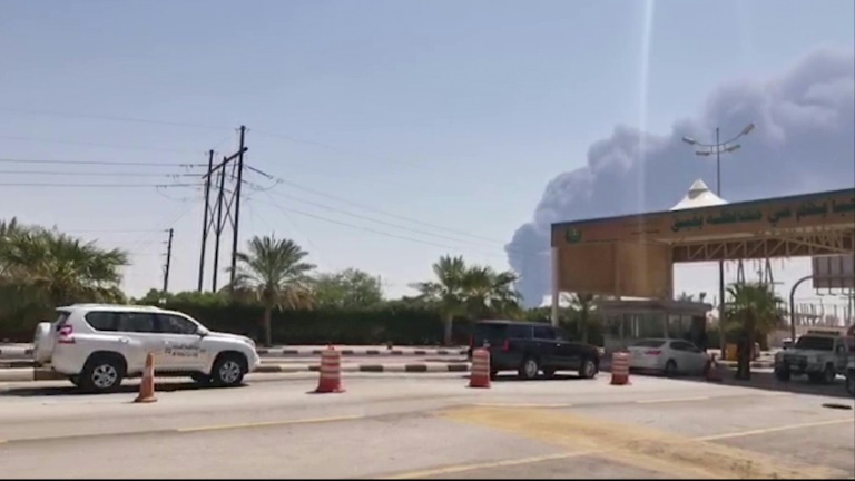 Smoke billows from Saudi oil giant Aramco's huge Abqaiq processing plant following a Saturday attack that Tehran insists was carried out by Yemeni rebels but Washington says originated in Iran.
