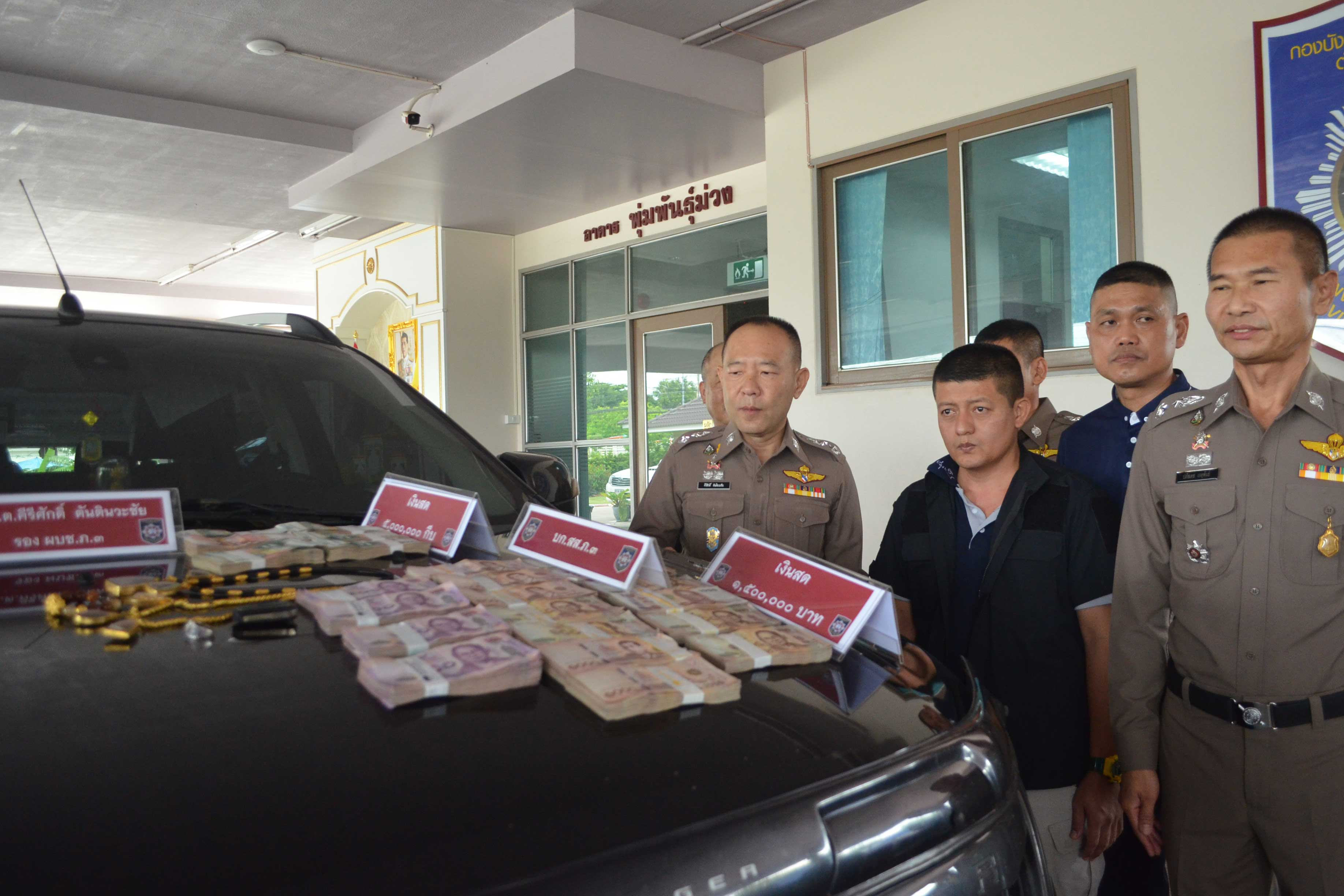 Police display money, a pickup truck and other valuables seized from an alleged money-launderer for a Laos drug network, at Provincial Police Region 3 in Nakhon Ratchasima on Thursday. (Photo by Prasit Tangprasert)