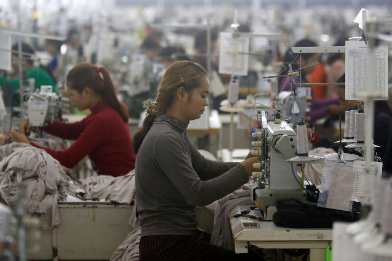 Employees work at a factory supplier of the H&M brand in Kandal province, Cambodia, on Dec 12, 2018. (Reuters photo)
