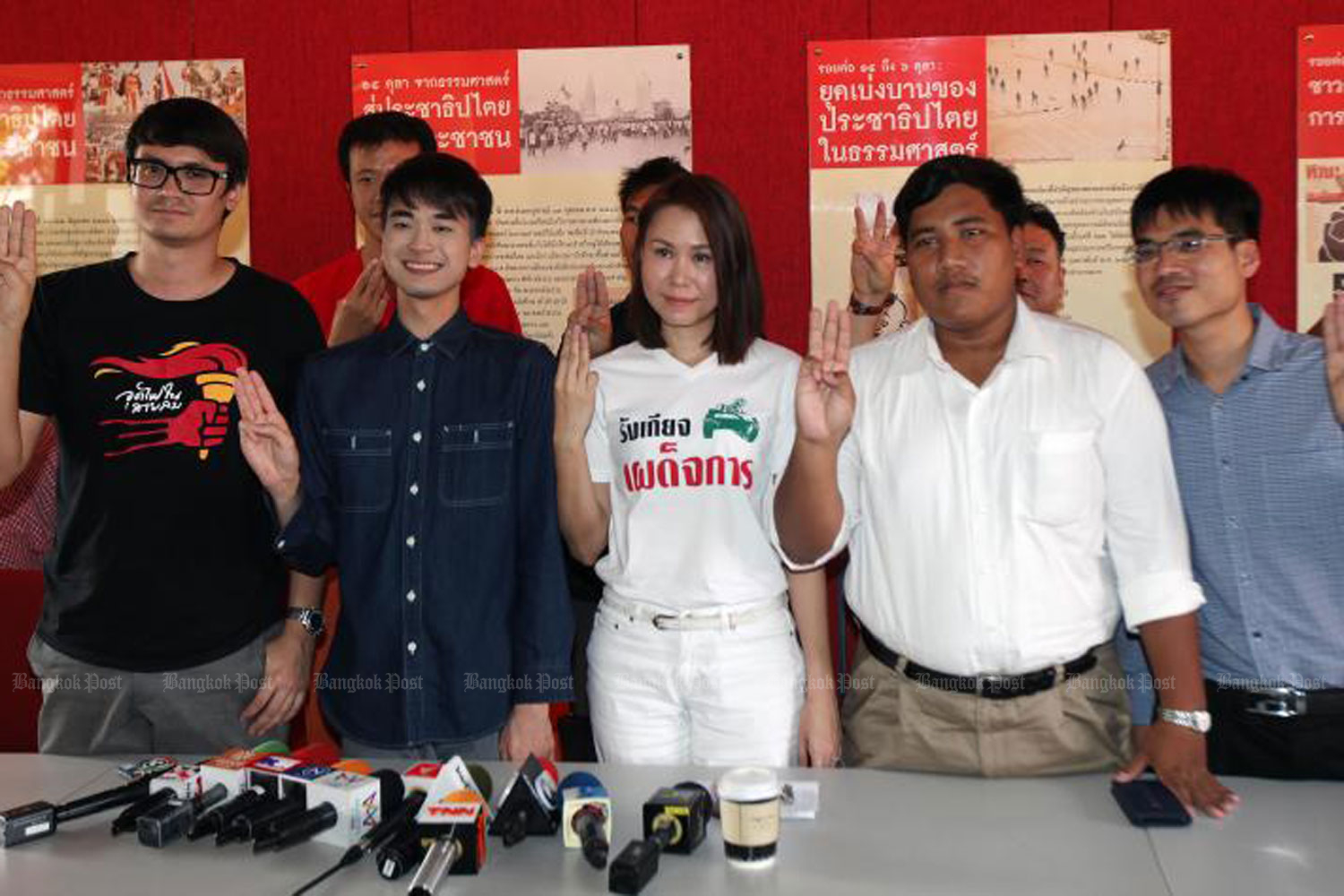"Rangsiman Rome, left, Sirawith ""Ja New"" Serithiwat, second right, and other pro-election activists during a press conference at Thammasat University in Bangkok on Feb 17 last year held in response to legal action against their rally on Feb 10, 2018. (File photo)"