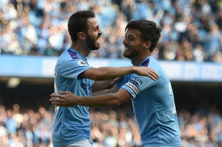 Manchester City's Bernardo Silva (left) celebrates with David Silva during their thrashing of Watford.