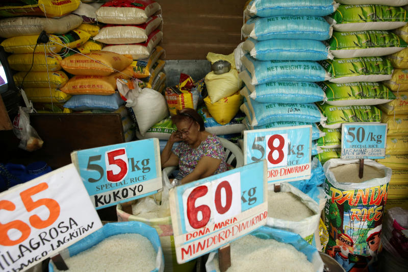 A vendor rests in her market stand that sells rice in Quezon City, Metro Manila in Philippines, Sept 5, 2018. (Reuters file photo)