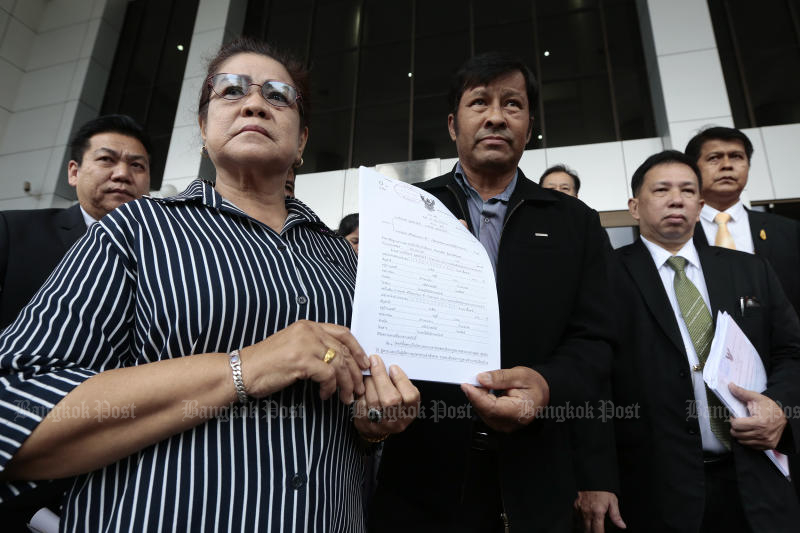 The parents of Nusara Suknamai, a victim in the helicopter crash which killed Leicester City soccer club owner, Vichai Srivaddhanaprabha, sue the deceased tycoon's family for 300 million baht in a civil suit on Monday. (Photo by Patipat Janthong)