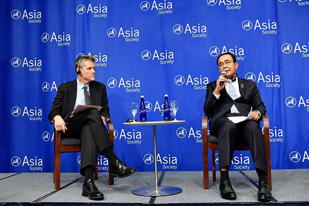Prime Minister Prayut Chan-o-cha answers a question during a talk at the Asia Society in New York on Wednesday. (Photo from @ThaigovSpokesman Facebook account)