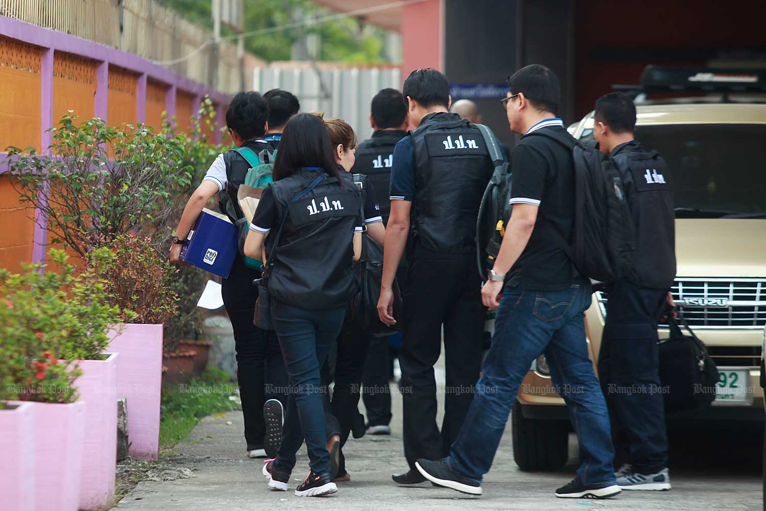 Representatives from the Public Sector Anti-Corruption Commission visit a state shelter in Bangkok to speak with girls rescued during the 2018 raid on the Victoria's Secret Massage parlour. (Bangkok Post file photo)