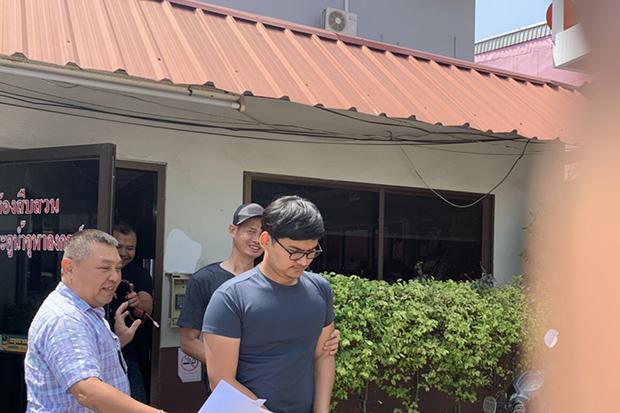 Police arrest Nonthakorn Kitiphakorn near Pratunam Chulalongkorn police station in Pathum Thani's Thanyaburi district on Sunday. (Crime Suppression Division photo)