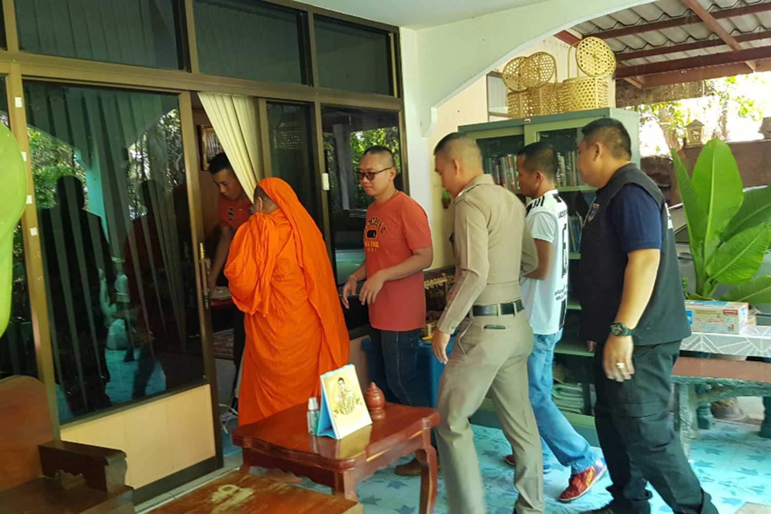 Phra Khru Wichian Panyaporn, 54, or Phra Pamitr, abbot of Wat Chom Sri in Muang district of Phetchabun province, at the provincial police head office after being arrested on a charge of indecent behaviour. (Photo by Soonthorn Kongwarakhom)