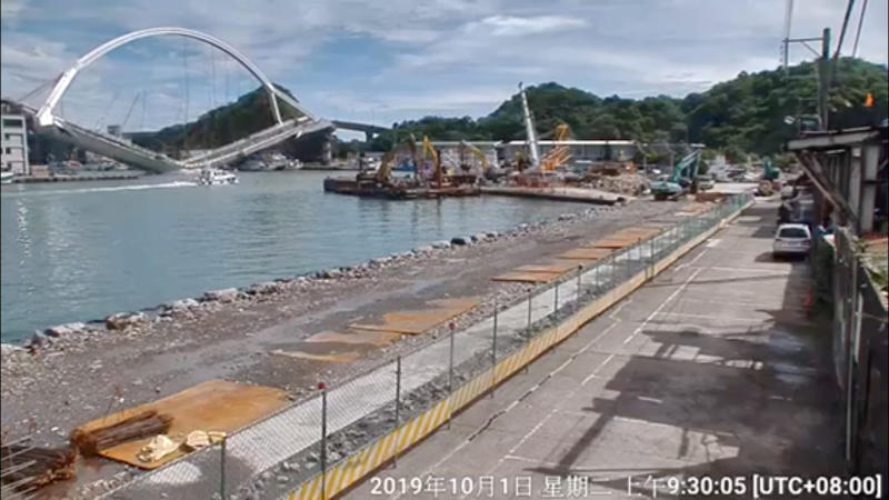 Nanfang'ao Bridge is seen collapsing in Suao, Taiwan on Tuesday in this still image taken from a video. (COAST PATROL CORPS 1 NORTHERN BRANCH, COAST GUARD ADMINISTRATION /via REUTERS)
