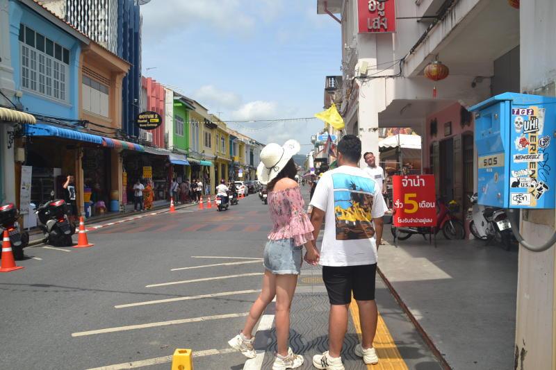 Tourists take photos at the old quarter of Phuket on Sept 18, 2019. (Photo by Achadtaya Chuennirun)