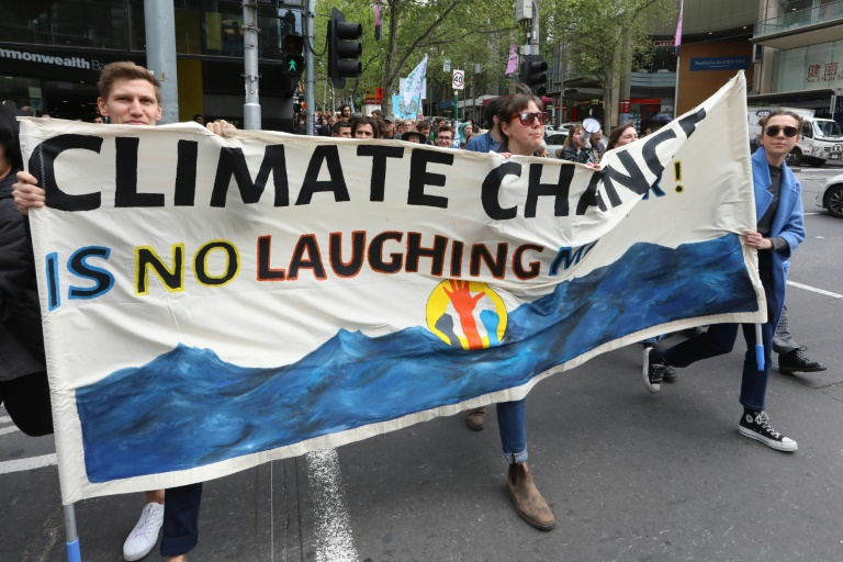 Climate protesters block bridges, stage rallies around the world