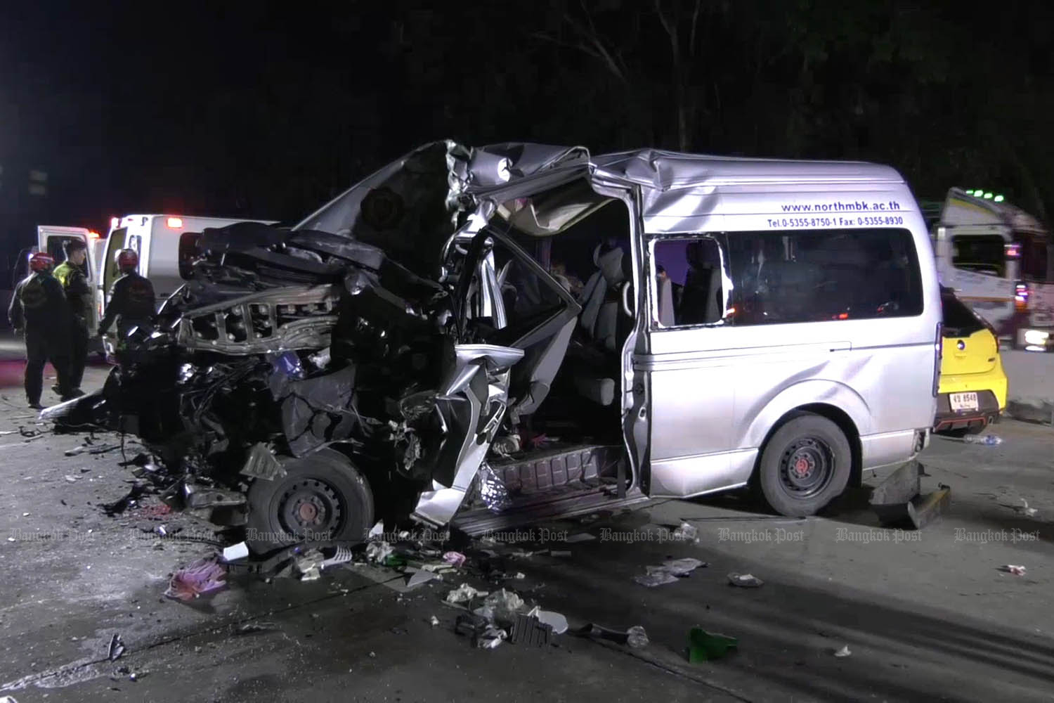 The wrecked passenger van after it ran into the rear of a lorry in Ko Kha district of Lampang on Tuesday. Three injured students on their way to receive study scholarships were killed. (Photo by Assawin Wongnorekaew)