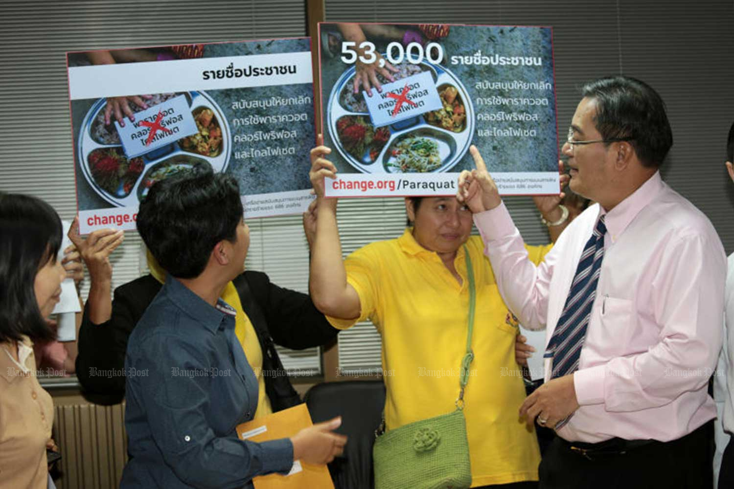 Activists gather at the Chartthaipattana Party headquarters on Oct 8 with placards showing that 53,000 people have signed a petition to ban three toxic farm chemicals. (File photo)