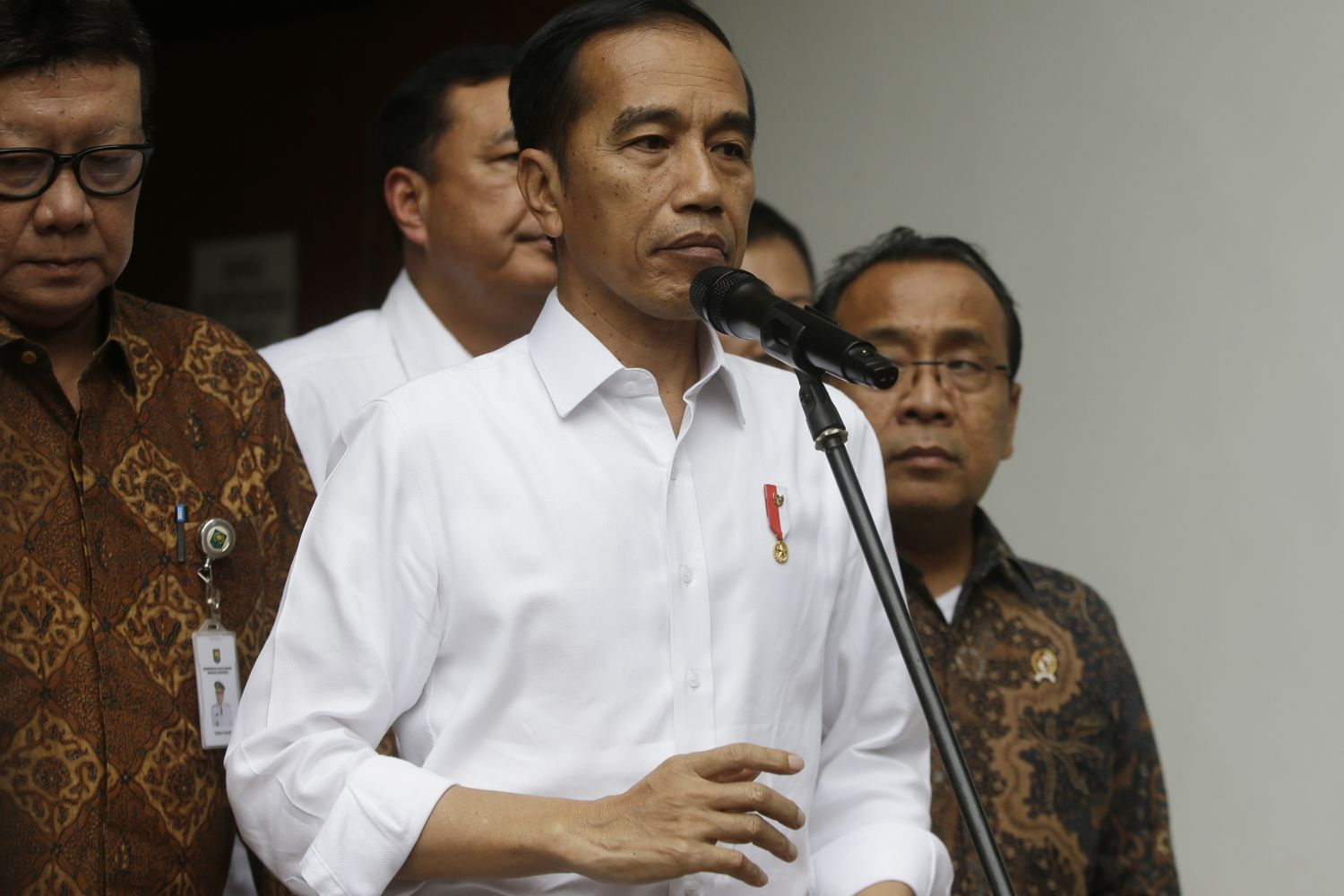 Indonesian President Joko Widodo (centre) speaks to journalists after visiting Coordinating Minister for Politics, Law and Security Wiranto who was wounded in a knife attack, at a hospital in Jakarta on Thursday. (AP photo)
