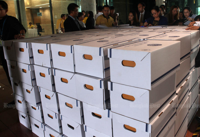Parliament officials inspect boxes containing 750 copies of the 2020 fiscal budget bill and other documents to be distributed to MPs and senators on Oct 8. (Bangkok Post photo)