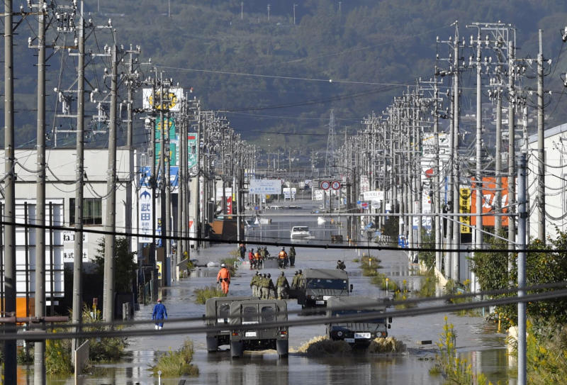 A residential area flooded by the Chikuma river caused by Typhoon Hagibis is seen in Nagano, central Japan, on Sunday. (Kyodo/via REUTERS)