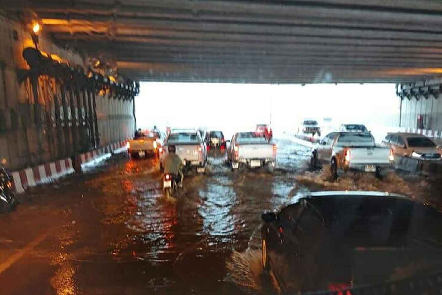 An underpass is flooded in Muang district of Chiang Mai province on Monday. (Photo by Panumet Tanraksa).