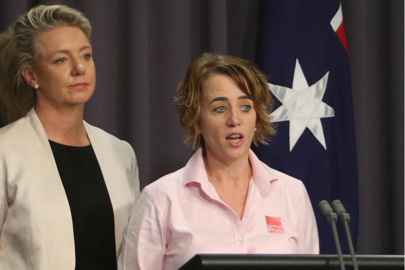 Australian Agriculture Minister Bridget McKenzie, left, and pork industry executive Margo Andrae address the media at Parliament House in Canberra, Australia on Tuesday, on the threat of African swine fever. (AP Photo)