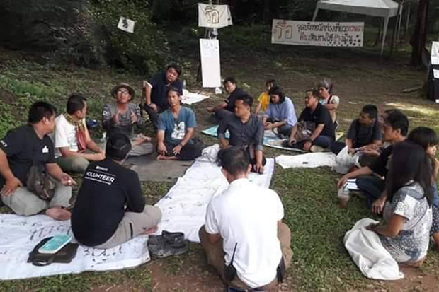 Conservationist Khemthong Morat (sitting in the middle) ended his hunger strike in Khao Yai National Park on Thursday.(Photo by Manit Sanubboon)