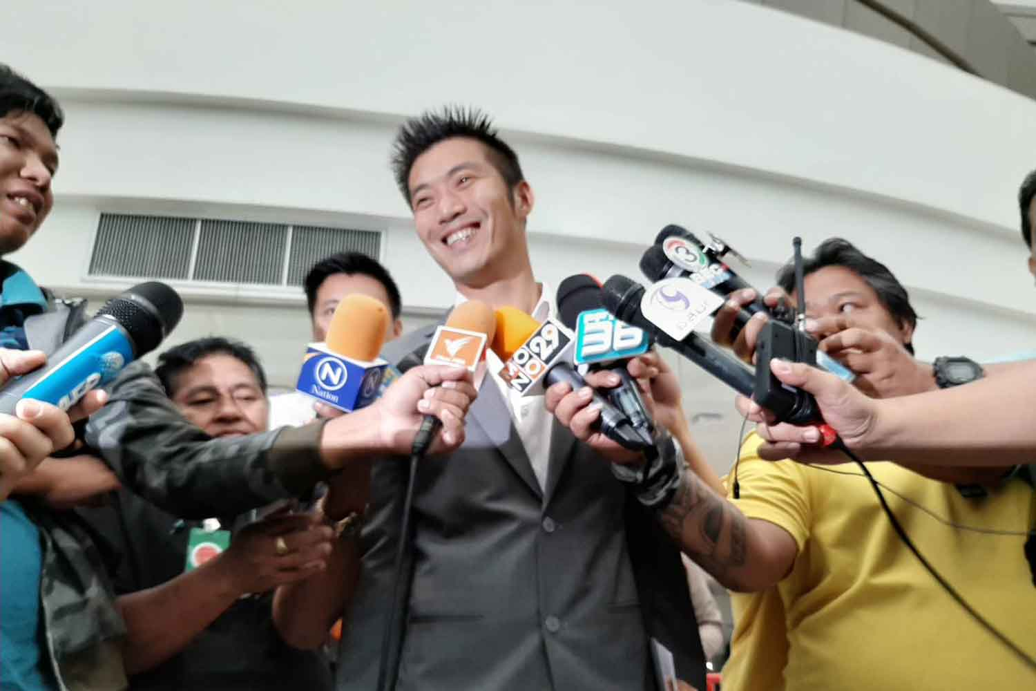 Future Forward Party leader Thanathorn Juangroongruangkit talks to reporters outside the Constitutional Court in Bangkok on Friday. (Photo supplied)